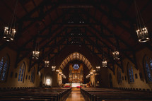 A large, empty church sanctuary with a soaring roof.