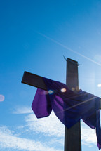 purple shroud draped over a cross