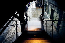 dark stairway leading to a wet sidewalk
