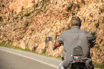 man riding on a motorcycle