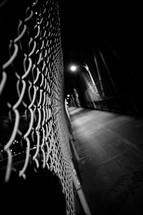 chain link fence in a dark alley