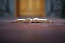 open Bible on a door step