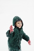 boy throwing a snow ball
