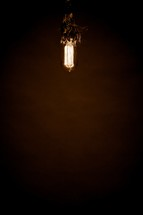 An old-fashioned light bulb hangs from the ceiling.