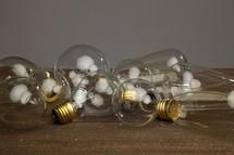 a group of lightbulbs on a table