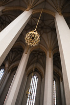 chandelier hanging from a cathedral celling