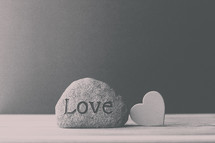 a rock with the word love