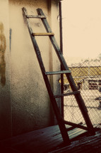 Wooden ladder against a wall