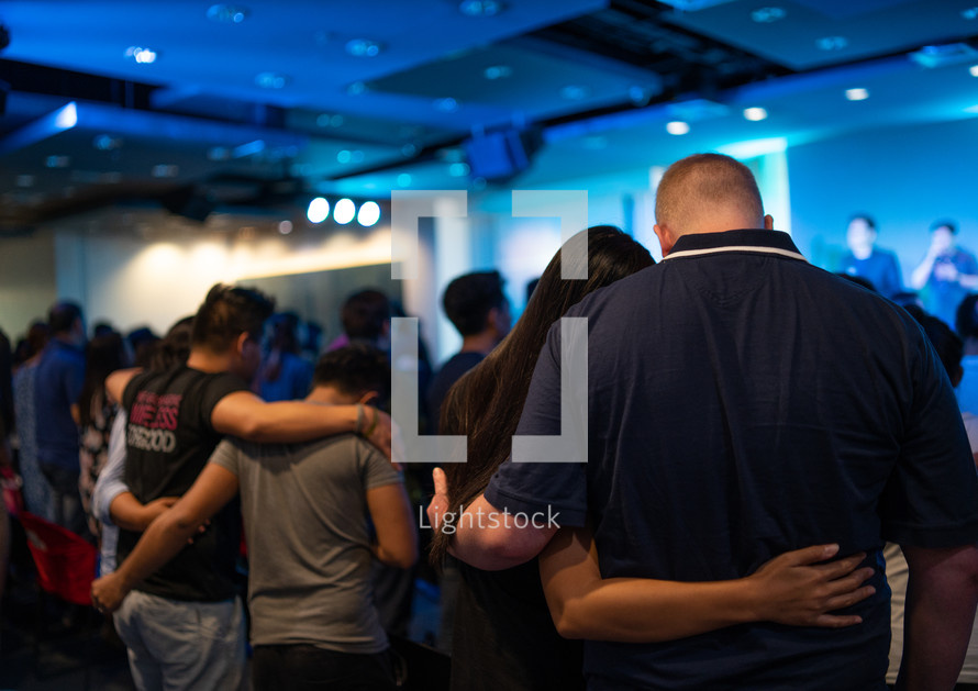 hugs during a worship service
