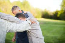 men praying together outdoors