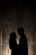 silhouette of a man and woman holding each other