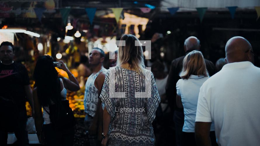 woman walking in a crowd