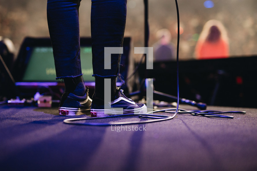 feet on a stage