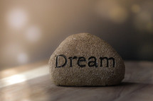 word dream on a stone