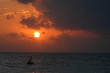 Sunset over the ocean and a buoy