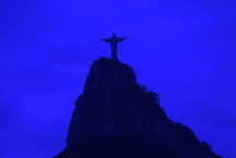 The Christ the Redeemer statue on top of the Corcovado mountain in Rio de Janeiro at dawn