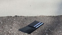 dropping a wallet on the sidewalk