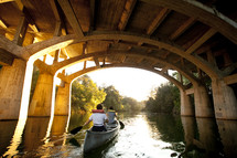 canoe under a bridge