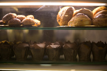 muffins and pastries in a display case