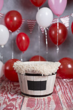 basket and red balloons