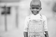 little girl in overhauls