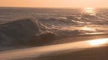 waves crashing into a shore