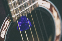a pick in guitar strings