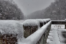 snow on a fence