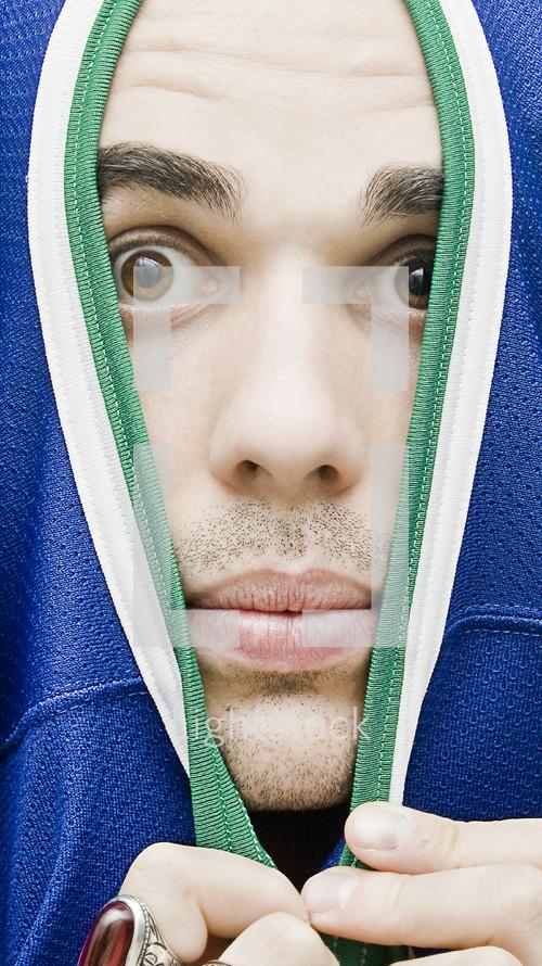 hiding man in a jersey