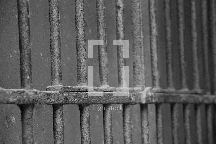Ancient prison bars in a holding cell