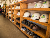 construction helmets and boots on a shelves