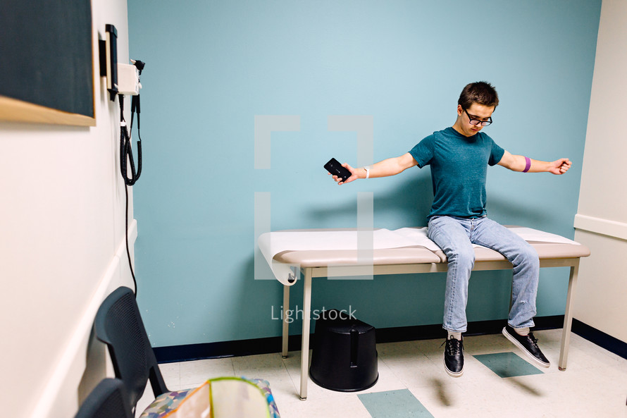 a teen boy at the doctor's office