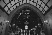 A church sanctuary with a soaring roof.
