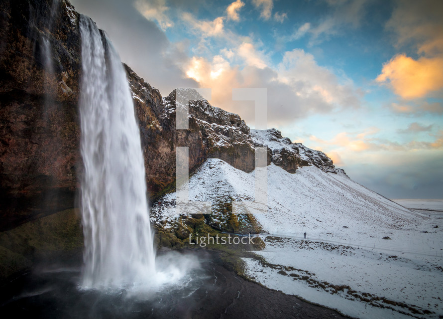 waterfall and snowy landscape