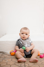 infant boy with Easter eggs