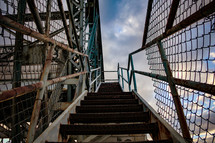 old metal stairs on bleachers