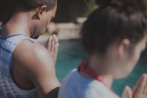 praying before a baptism