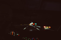 dashboard of a car driving at night