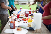 food on a table at an outdoor cookout