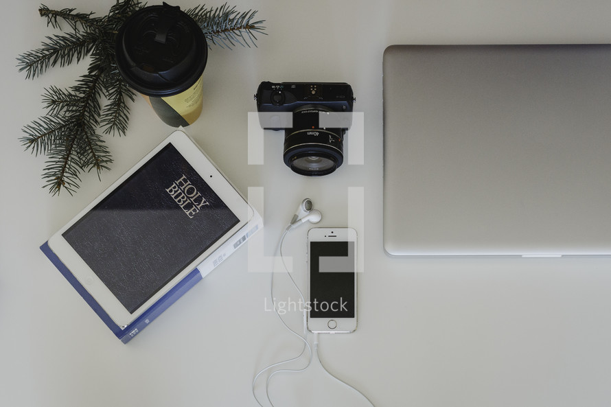 camera, phone, iPhone, cellphone, laptop, desk, pine boughs, camera lens, desk, coffee cup, winter, earbuds, Bible