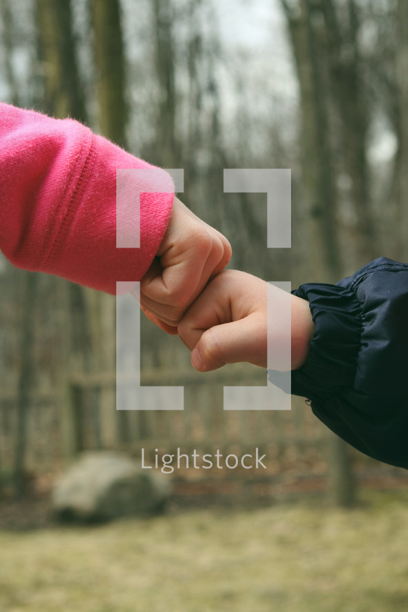 brother sister fist bump
