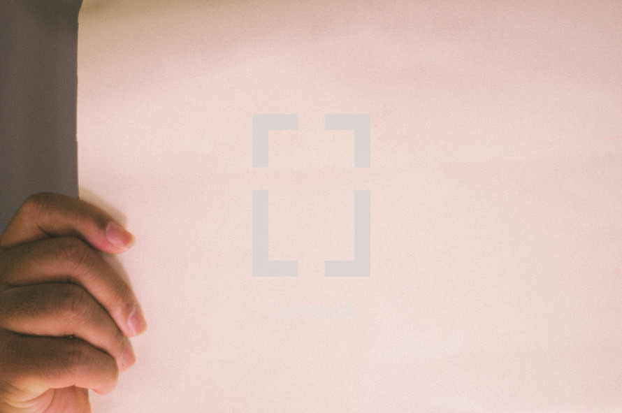 hand holding a blank paper