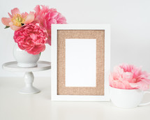pink flowers, blank frame, and, mug on a white background