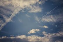 rocket streak in a sky and clouds