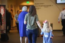 families walking into church