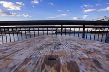 weathered wood and railing near a bay