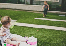 kids playing in the grass