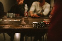 A group of men playing a poker game.