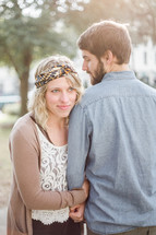 portrait of a couple standing together outdoors