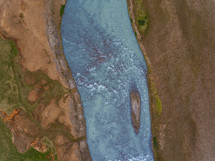 aerial view over a frozen river